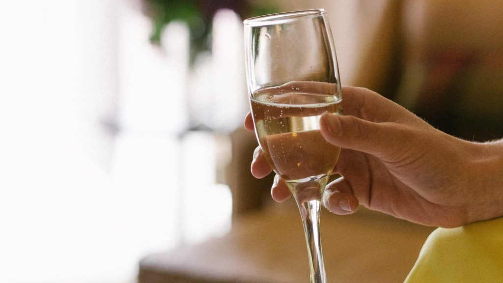 Champagne Glass and Hand
