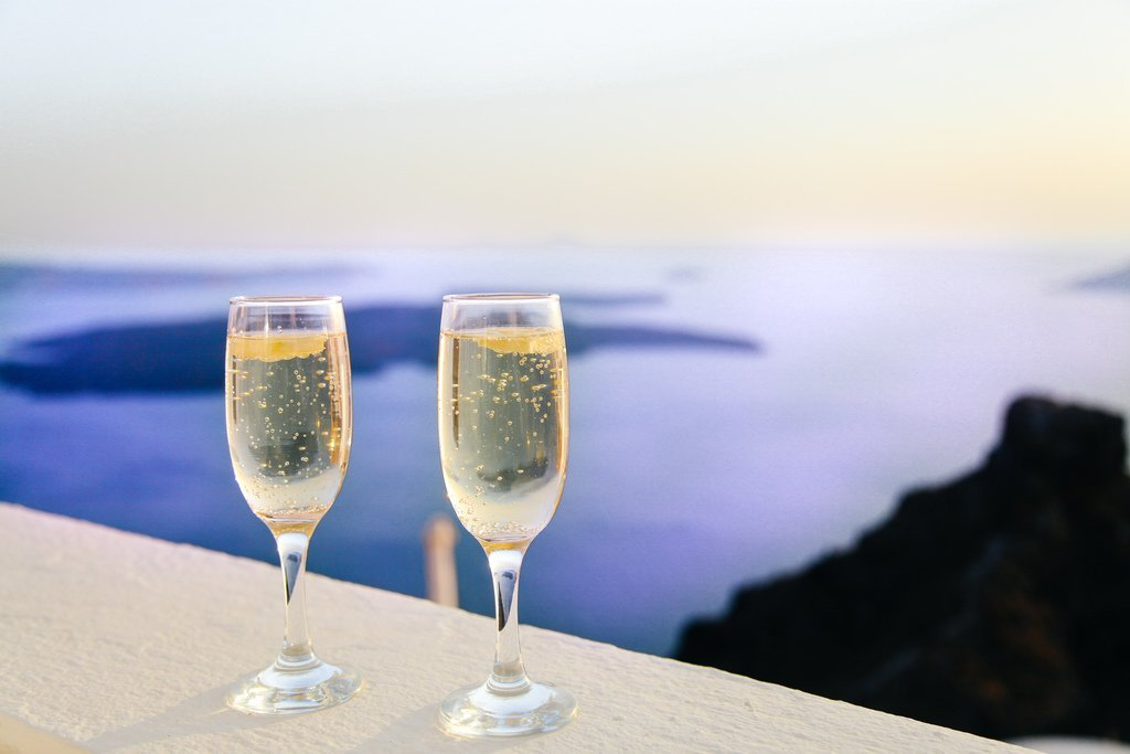 Two Champagne Glasses in front of the ocean