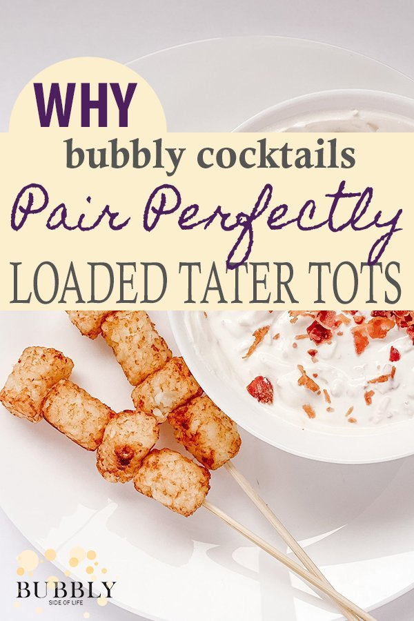 Why bubbly cocktails pair perfectly with loaded tater tots - loaded tater tots on white plate with dipping sauce