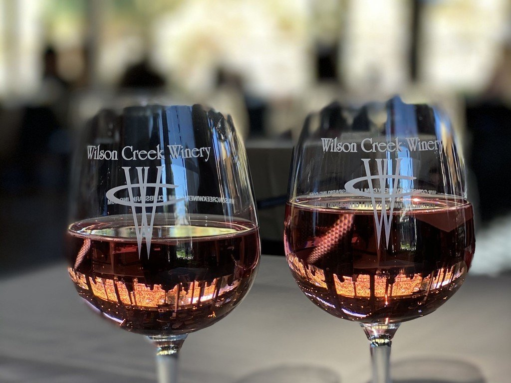 Two Wilson Creek Winery Glasses of Pink Champagne closeup