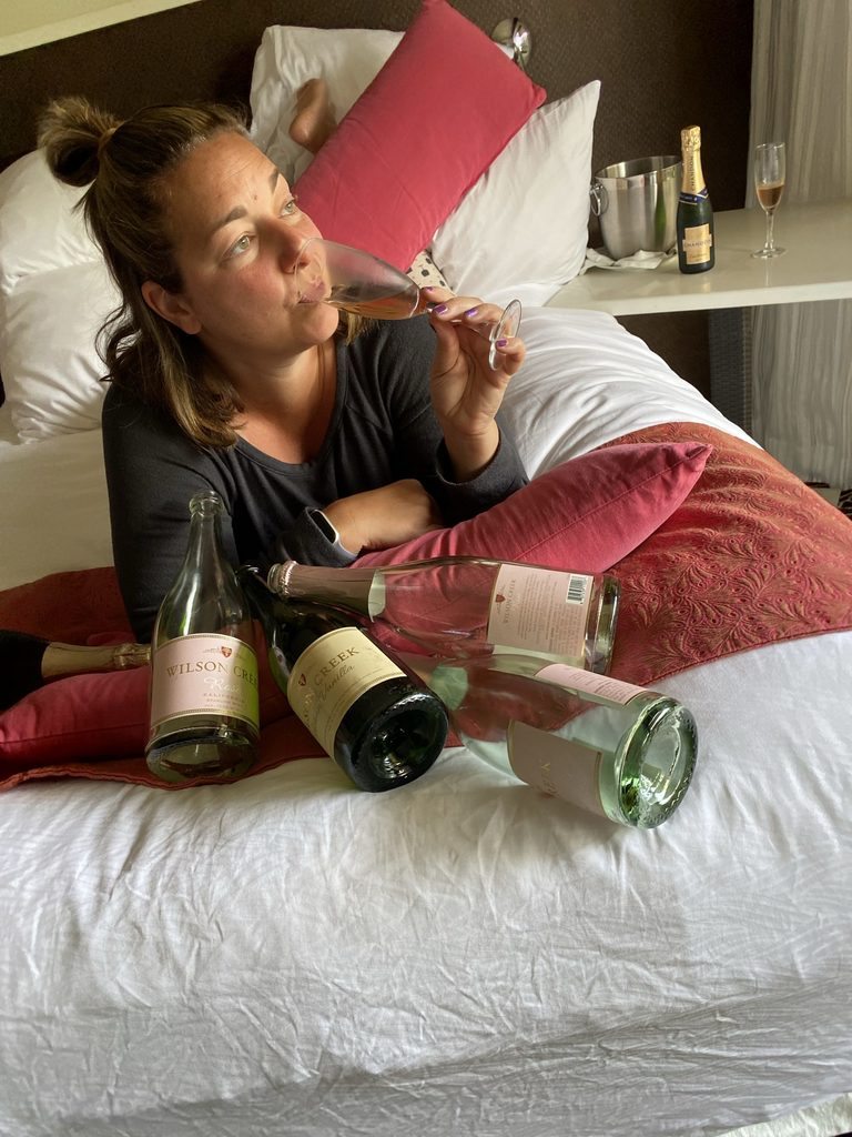 Woman drinking champagne in bed