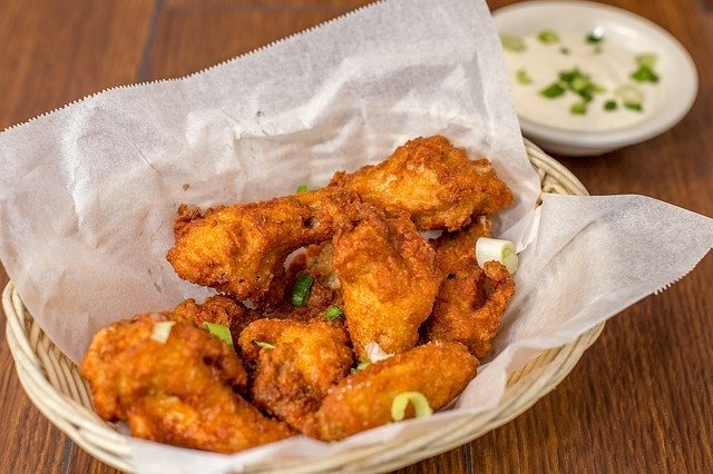Fried chicken wings really do pair well with bubbly.