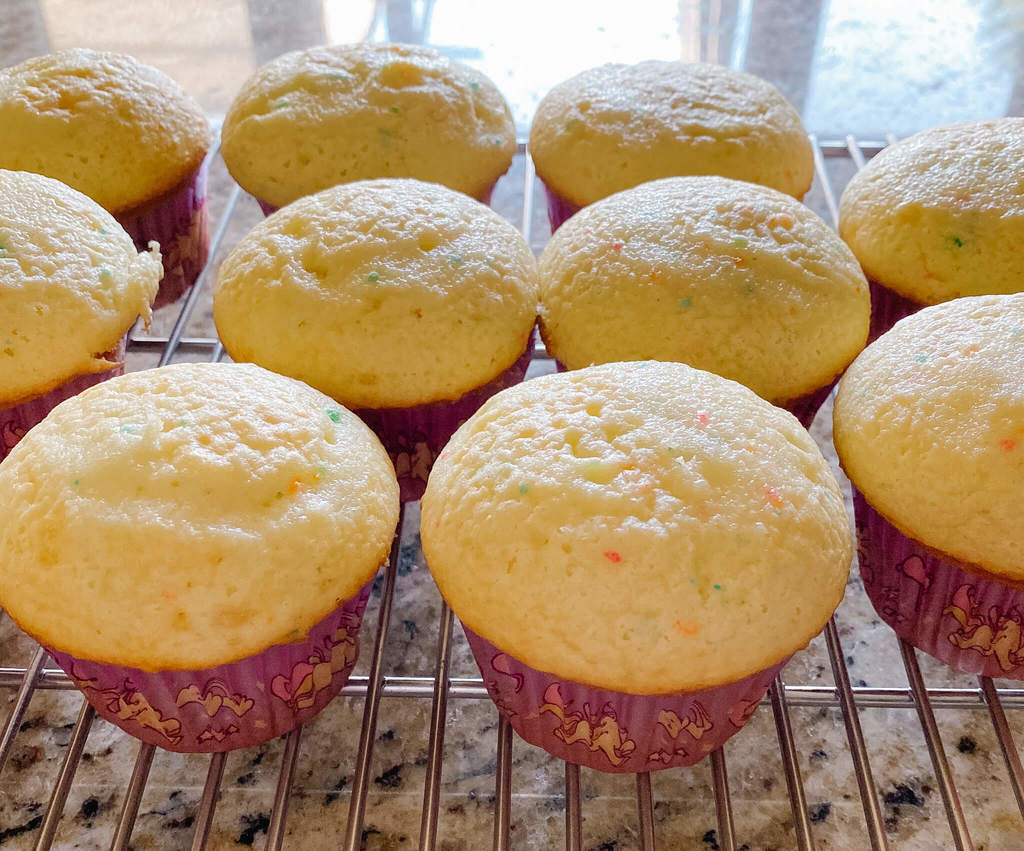 Light and airy, overflowing bubbly cupcakes.