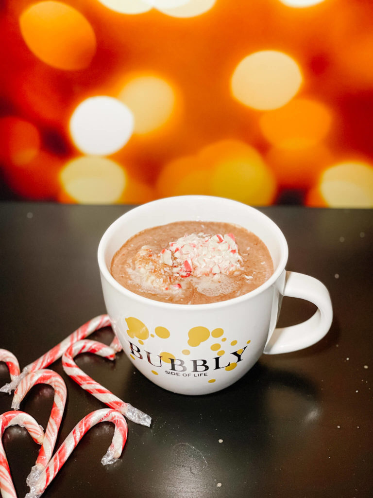 Sparkling red wine hot chocolate topped with Bubbly Whipped Cream.