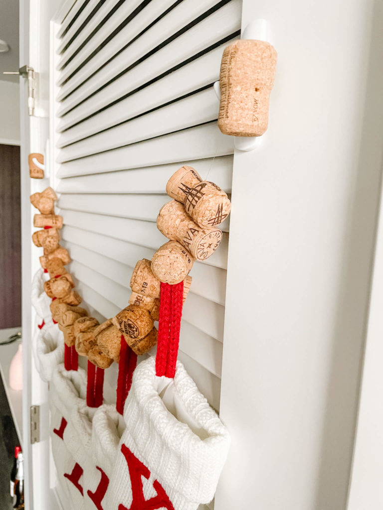Hanging your cork garland with the cork and Command Hooks.
