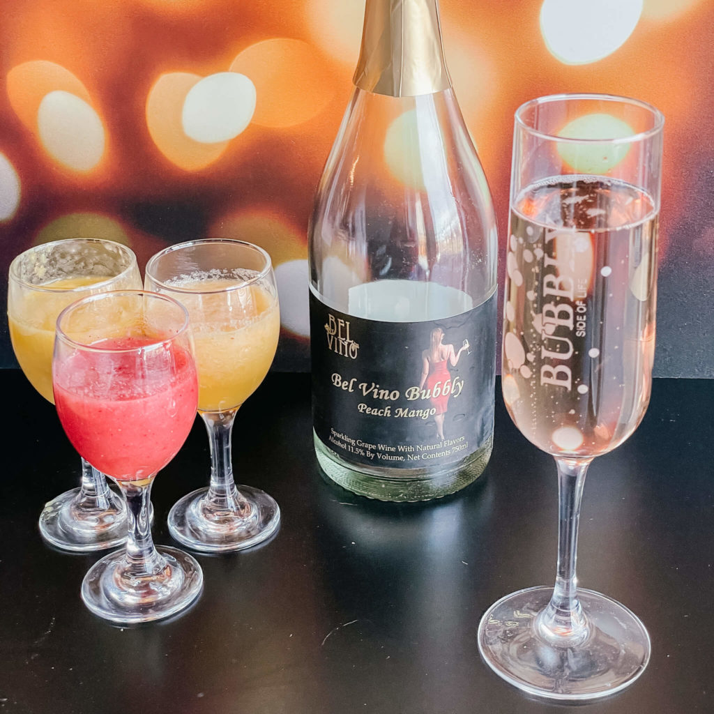 Mimosa cocktails with summer fruits.