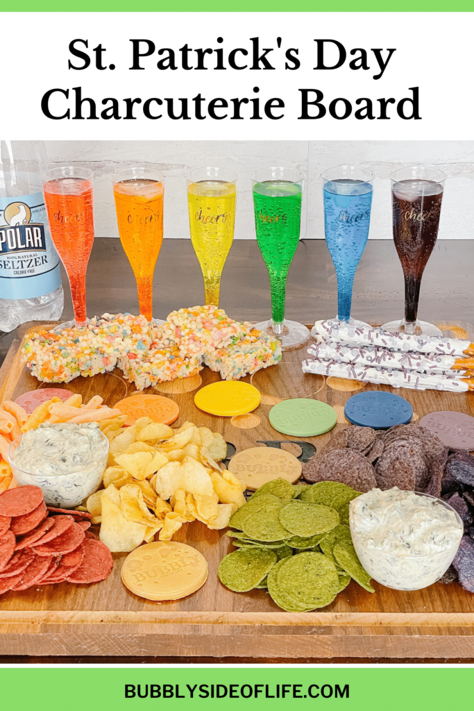 We have created a custom charcuterie board to celebrate St. Patrick's Day with this amazing rainbow theme! This Saint Patrick's Day charcuterie board is full of easy snack and easy treat ideas. Create your own St. Patrick's Day Charcuterie board here! | St. Patrick's Day | Saint Patrick's Day | Charcuterie Board