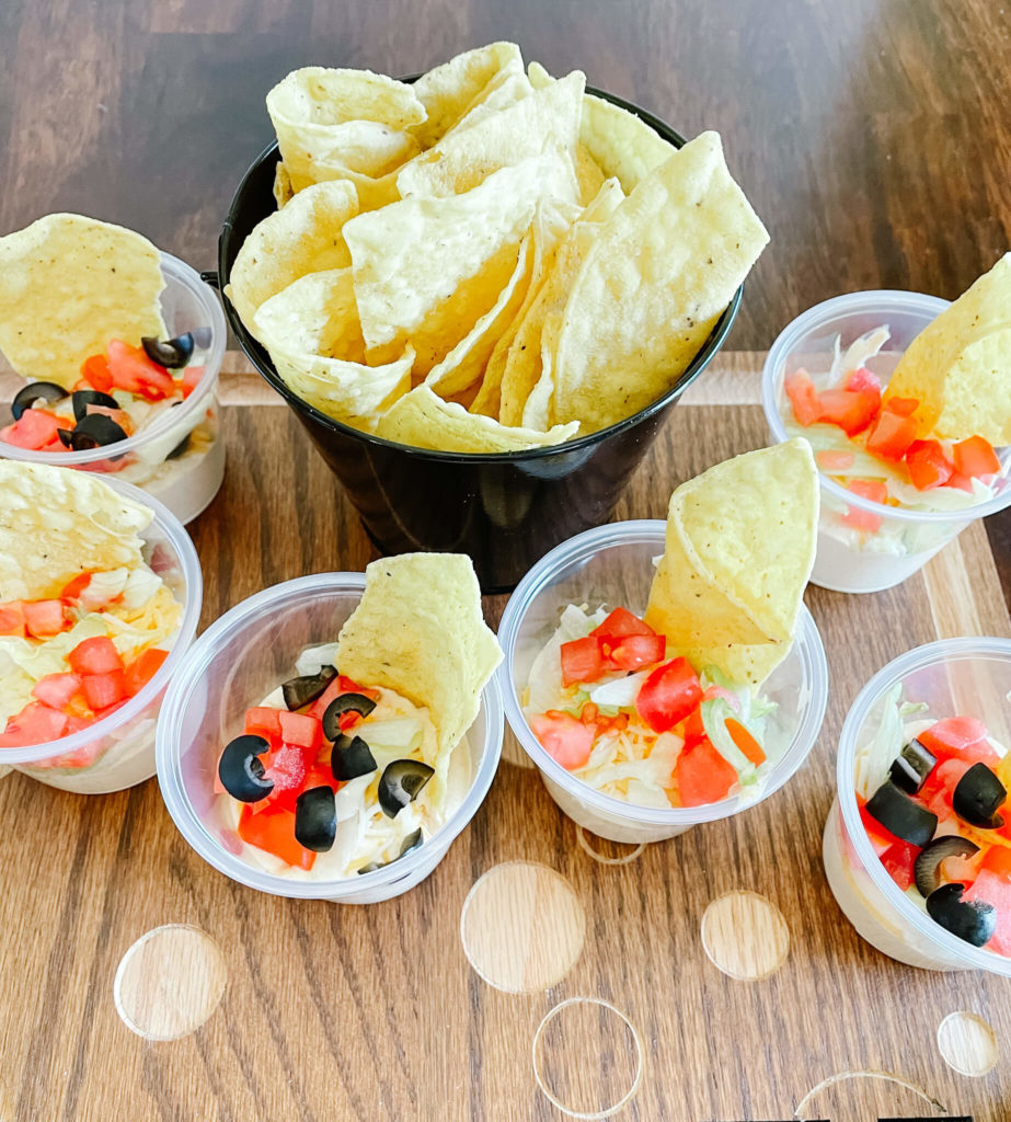 Cheater taco dip cups for your Mexican Charcuterie board.