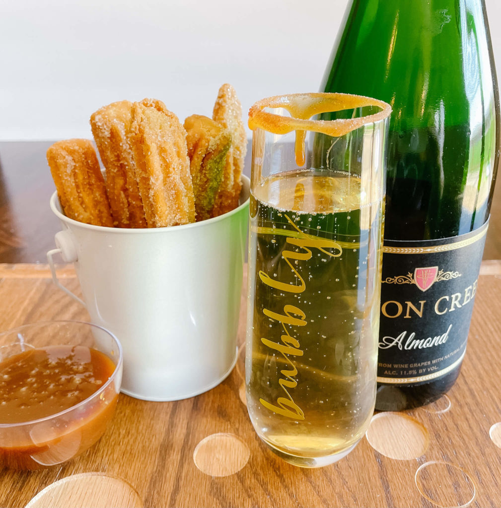 The perfect dessert for your Mexican Charcuterie Board:  churros and sparkling almond wine!
