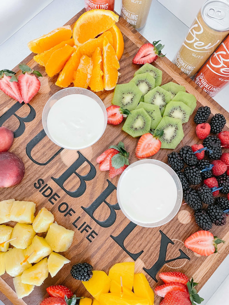 Fruit charcuterie board with a fruit bubbly dip everyone will love!